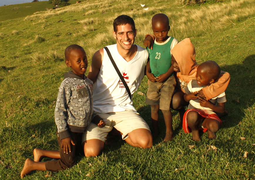 a volunteer playing with kids from Lubanzi village